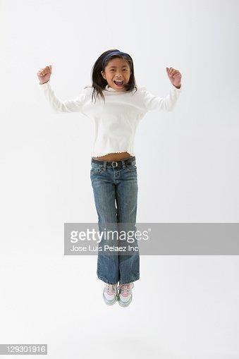 Filipino girl cheering and jumping : Stock Photo