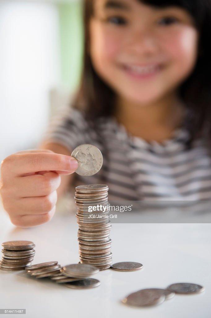 Filipino girl counting coins