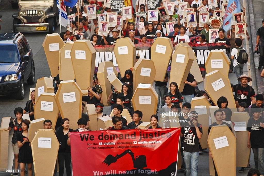 Filipino journalists and journalism students hold up mock coffins during the Remembrance Day Rally commemorating the 34 journalists massacred by paramilitary forces exactly three years ago on November 23, 2012 in Manila, Philippines. The slain journalists were part of a convoy traveling with the wife of a local politician who was going to file her husband's certificate of candidacy. The Maguindanao massacre of November 23, 2009, left 58 people dead, the highest number of journalists killed in a single incident anywhere in the world.
