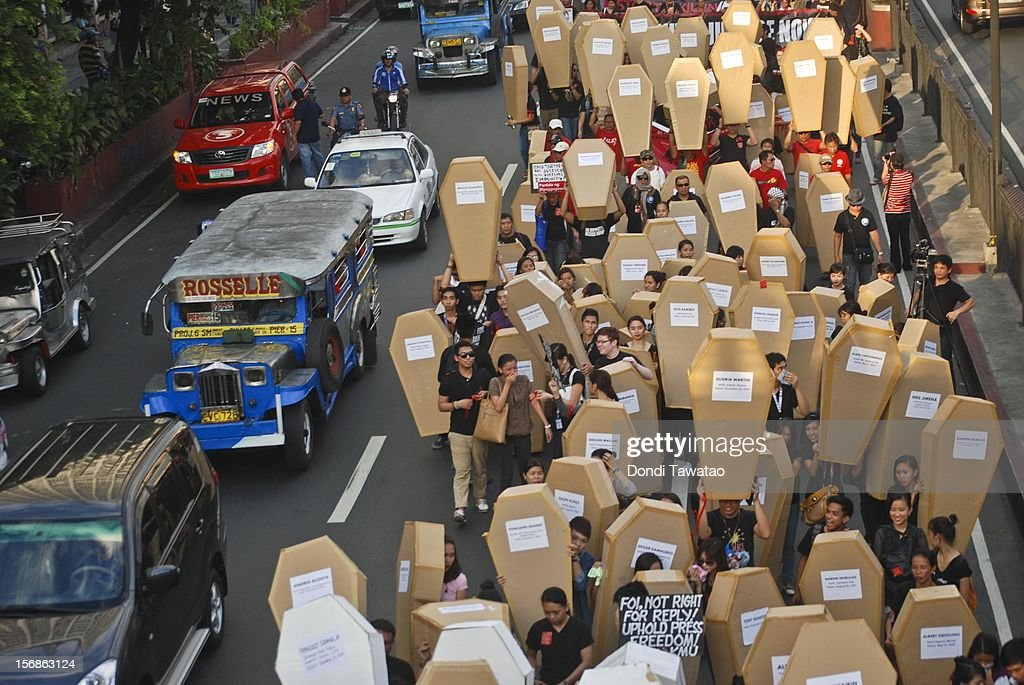 Filipino journalists and journalism students hold up mock coffins during the Remembrance Day Rally commemorating the 34 journalists massacred by paramilitary forces exactly three years ago on November 23, 2012 in Manila, Philippines. The slain journalists were part of a convoy traveling with the wife of a local politician who was going to file her husband's certificate of candidacy. The Maguindanao massacre of Nov. 23, 2009, left 58 people dead, the highest number of journalists killed in a single incident anywhere in the world.
