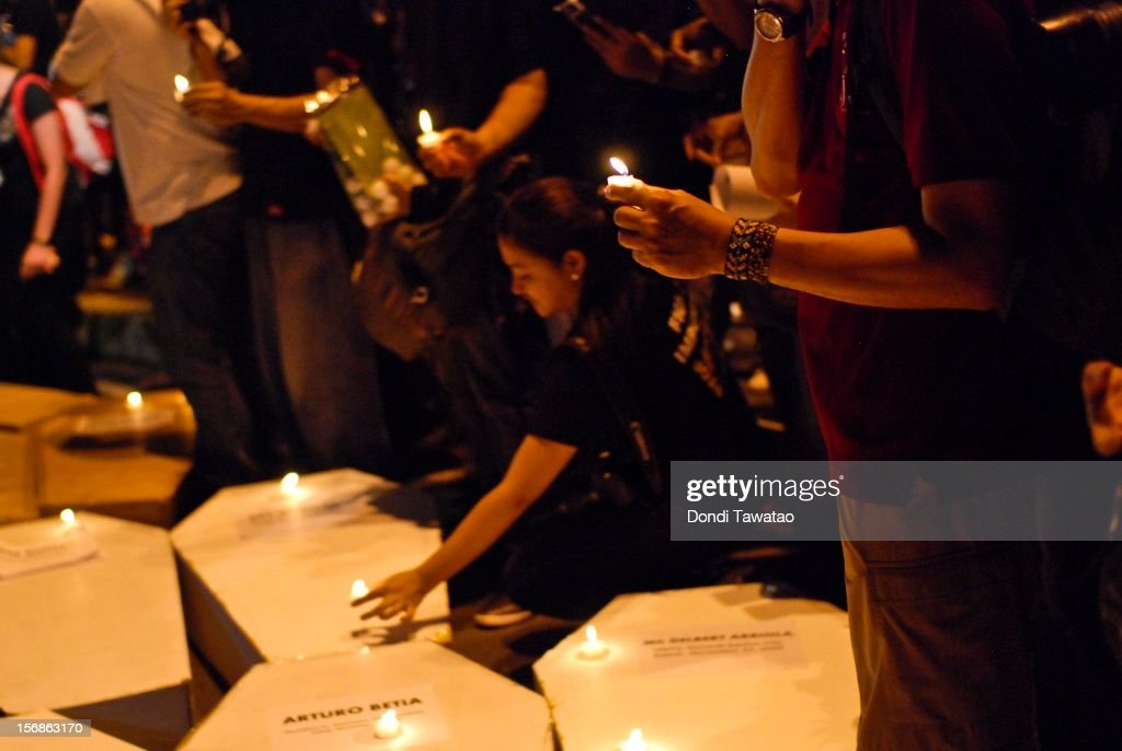 Filipino journalists and journalism students light candles in prayer during the Remembrance Day Rally commemorating the 34 journalists massacred by paramilitary forces exactly three years ago on November 23, 2012 in Manila, Philippines. The slain journalists were part of a convoy traveling with the wife of a local politician who was going to file her husband's certificate of candidacy. The Maguindanao massacre of Nov. 23, 2009, left 58 people dead, the highest number of journalists killed in a single incident anywhere in the world.