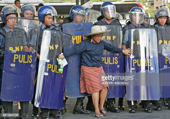 Filipino laborers clash with police personnel in Makati City November 16 2015 Many workers are protesting the policies of large businesses and...