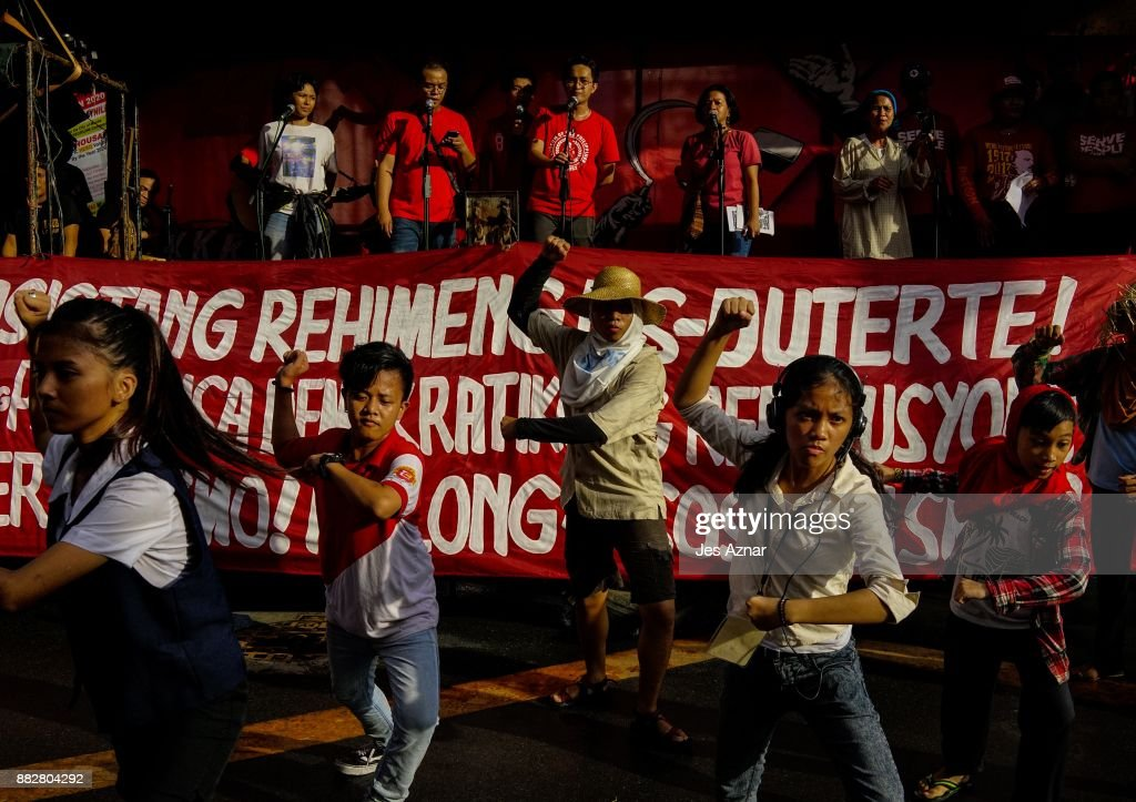 Filipino leftist protesters march against President Rodrigo Duterte on the streets on November 30, 2017 in Manila, Philippines. After announcing his withdrawal from the peace talks with communist rebels that subsequently led to a step up in operations by the Philippine military and killing 15 New People's Army members, President Duterte hints on an crackdown to go after the left's legal organizations and other human rights groups. The announcement prompted an uproar among leftist groups while shouting a call for civil war as answer to Duterte's alleged fascist tendencies. The New People's Army is the longest running insurgency of more than 40 years that has sprung as a response to the Marcos dictatorship in the 60s.