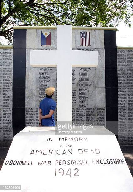 Filipino looks at the lists of names at the Capas National Shrine to remember those who lost their lives in WWII's Bataan Death March on October 26...