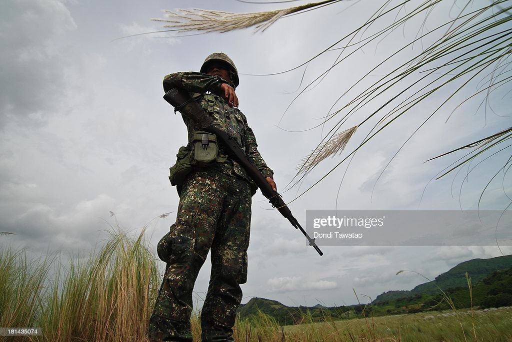 Filipino Marine soldier looks on during a military training exercise in Crow Valley, September 21, 2013 in Tarlac province, Philippines. Around three thousand U.S. Marines are in the country for the Phiblex amphibious marine exercise with their Philippine counterparts. The war games maneuvers run for three weeks in various locations in the Philippines.