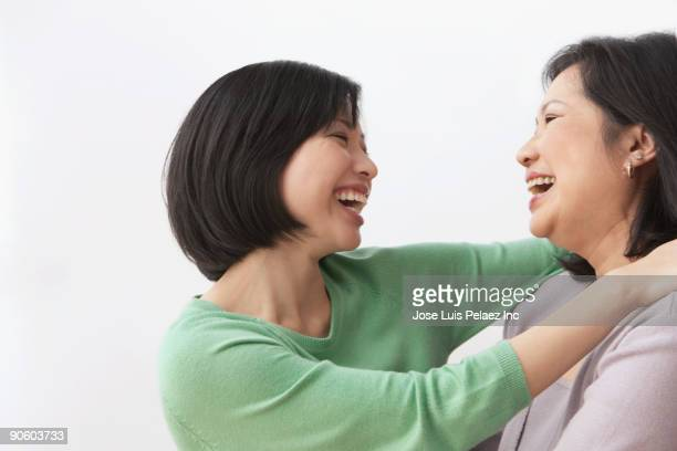 Filipino mother and daughter hugging