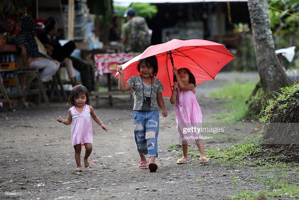 Filipino Muslim children paly inside a rebel camp on October 10, 2012 in Sultan Kudarat township, southern Philippines. President Benigno Aquino claimed the latest development in the negotiation with the rebels is a major milestone after decades of militant insurgency in the nation's troubled south. Both parties are expected to sign the peace agreement on October 15, 2012.