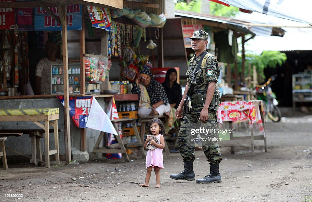 A Filipino Muslim rebel walks inside rebel camp on October 10, 2012 in Sultan Kudarat township, southern Philippines. President Benigno Aquino claimed the latest development in the negotiation with the rebels is a major milestone after decades of militant insurgency in the nation's troubled south. Both parties are expected to sign the peace agreement on October 15, 2012.