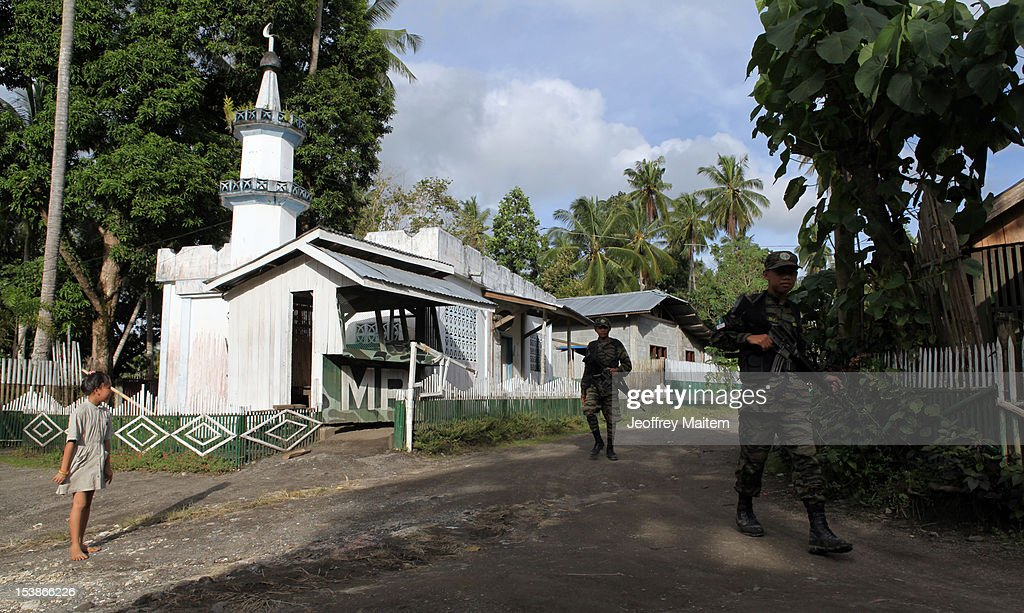 Filipino Muslim rebels of the Moro Islamic Liberation Front, the country's largest rebel group in the Philippines, walk inside their camp on October 10, 2012 in Sultan Kudarat township, southern Philippines. President Benigno Aquino claimed the latest development in the negotiation with the rebels is a major milestone after decades of militant insurgency in the nation's troubled south. Both parties are expected to sign the peace agreement on October 15, 2012.