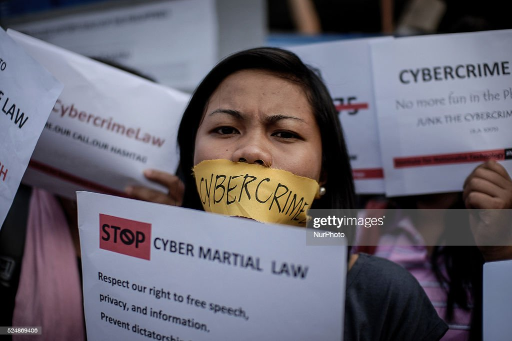A Filipino netizen takes part in a demonstration versus a new law making online libel a criminal offence at the EDSA Shrine in Quezon city northeast...