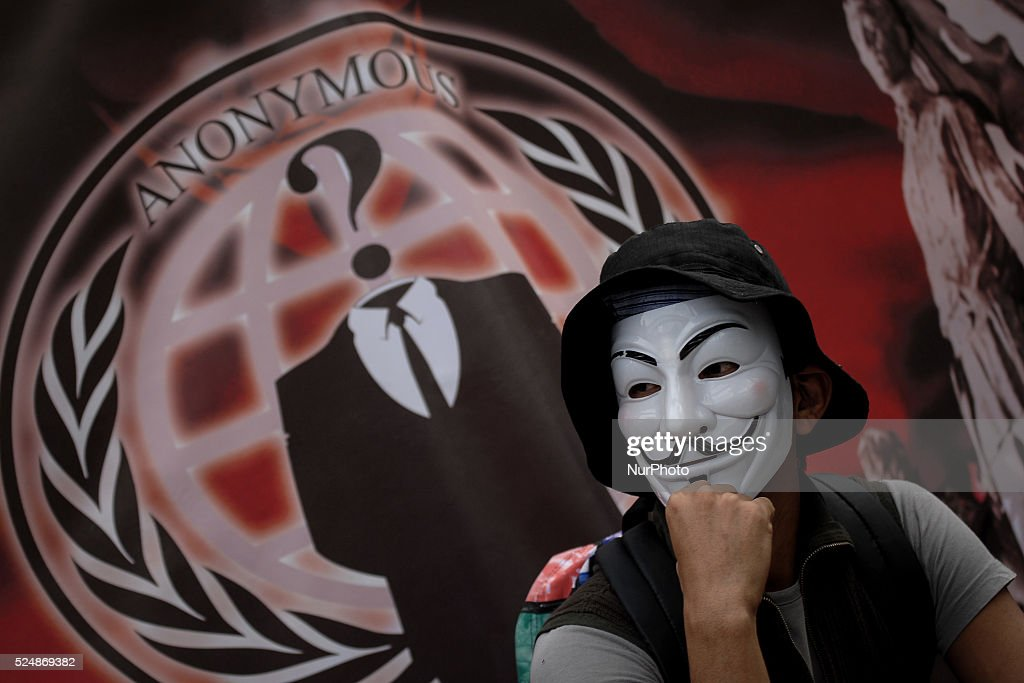 A Filipino netizen wearing a Guy Fawkes mask takes part in a demonstration versus a new law making online libel a criminal offence at the EDSA Shrine...