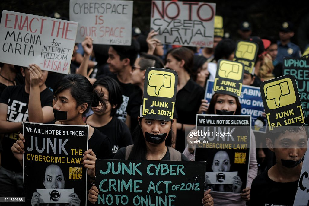 Filipino netizens hold placards during a demonstration versus a new law making online libel a criminal offence at the EDSA Shrine in Quezon city...