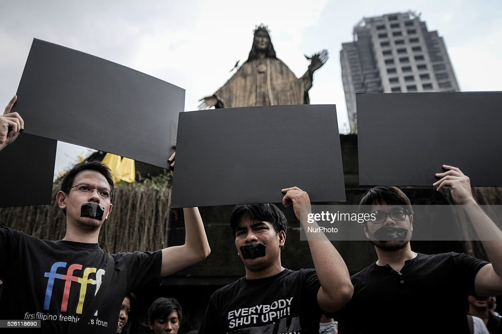 Filipino netizens hold up blank placards during a demonstration versus a new law making online libel a criminal offence at the EDSA Shrine in Quezon...