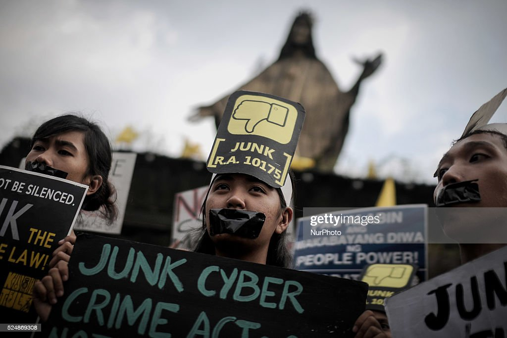 Filipino netizens take part in a demonstration versus a new law making online libel a criminal offence at the EDSA Shrine in Quezon city northeast of...