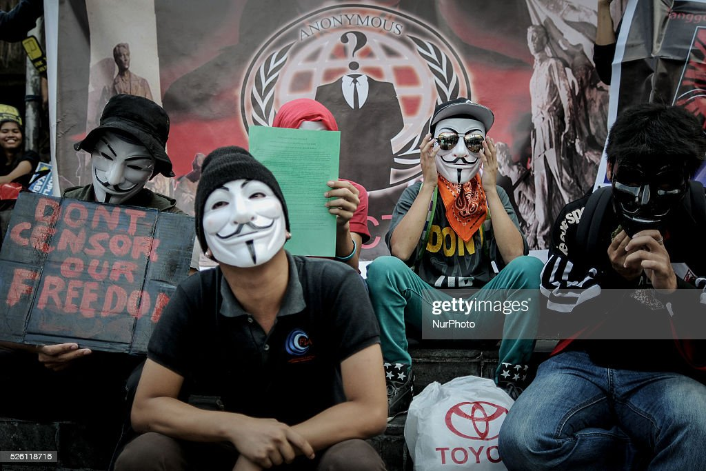 Filipino netizens wearing Guy Fawkes masks take part in a demonstration versus a new law making online libel a criminal offence at the EDSA Shrine in...