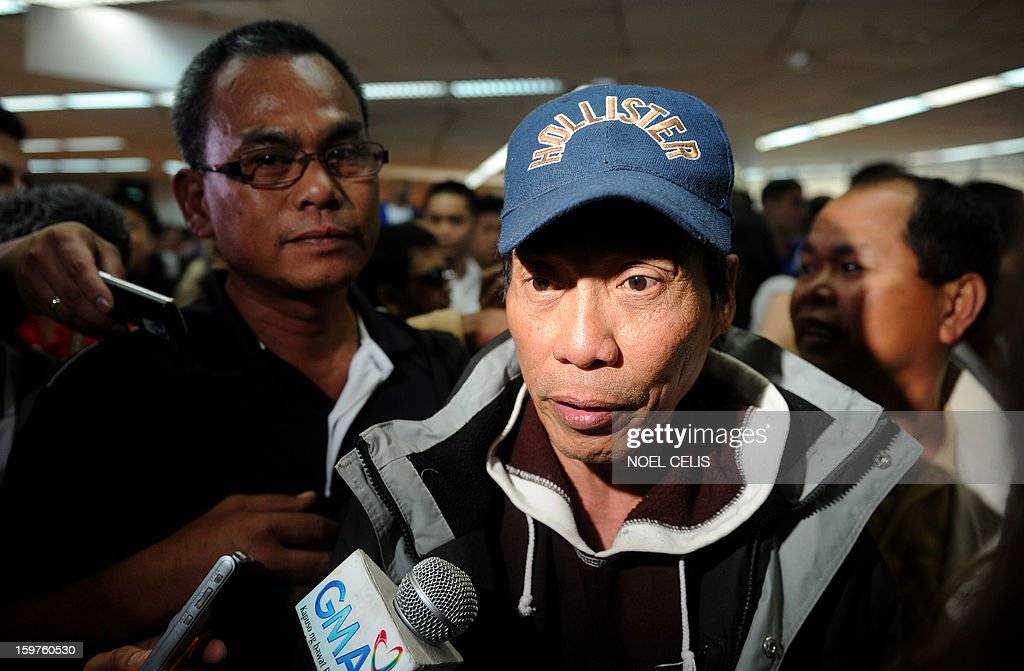 A Filipino overseas worker (R) is interviewed by the press upon his arrival at Manila International Airport on January 20, 2013 after being sent home by his employer in Algeria due to security fears following an Islamic militant attack at a remote gas plant. Many of the 39 returnees said they worked for a British energy facility hundreds of kilometres from the In Amenas gas plant that was attacked by the militants last week. AFP PHOTO / NOEL CELIS