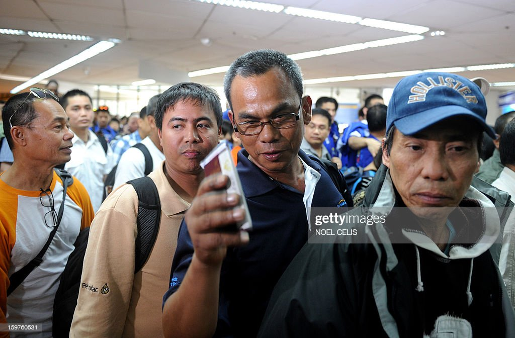 Filipino overseas workers arrive at Manila International Airport on January 20, 2013 after being sent home by their employer in Algeria due to security fears following an Islamic militant attack at a remote gas plant. Many of the 39 returnees said they worked for a British energy facility hundreds of kilometres from the In Amenas gas plant that was attacked by the militants last week. AFP PHOTO / NOEL CELIS