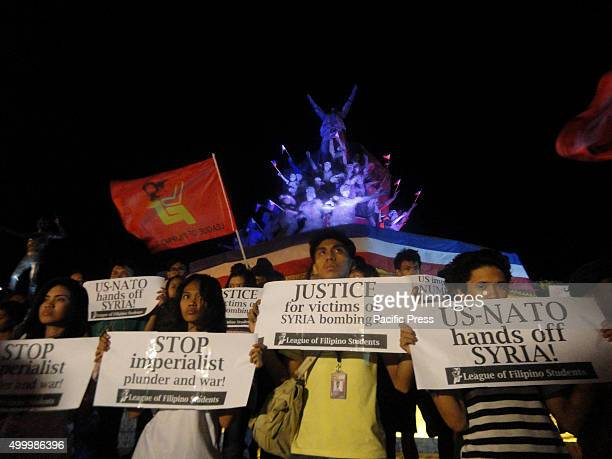 Filipino protesters hold slogans protesting the planned retaliatory airstrikes by the United States and the United Kingdom in Syria during a rally in...