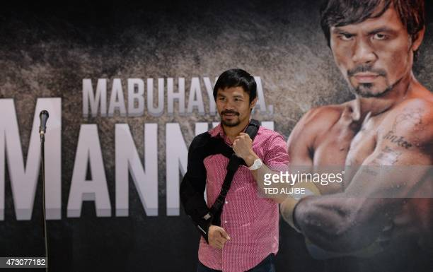 Filipino ring icon Manny Pacquiao poses for photo after a press conference shortly after arriving from the US at the international airport in Manila...