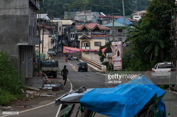 Filipino soldier run for cover as they advance towards ISISlinked militants on May 30 2017 in Marawi city southern Philippines Philippine government...