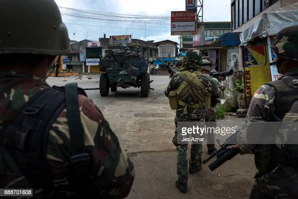 Filipino soldiers clearing a city street of militants on May 26 2017 in Marawi city southern Philippines Filipino officials announced on Friday that...