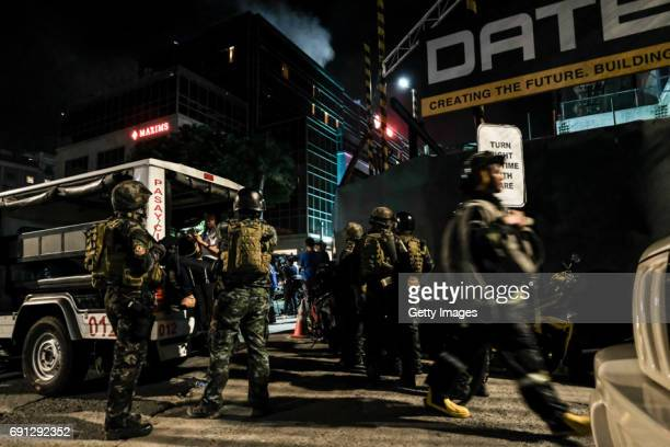 Filipino soldiers take their position outside Resorts World Manila after gunshots and explosions were heard in Pasay City on June 2 2017 in Manila...