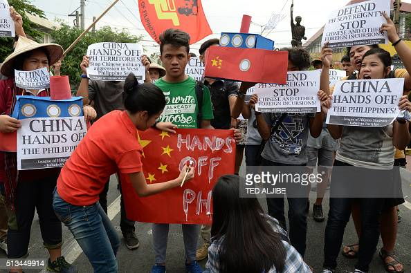 Filipino students shout antiChinese slogans during a rally near Malacanang Palace in Manila on March 3 to denounce reported Chinese vessels dropping...