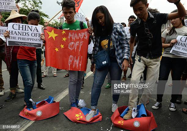 Filipino students step on replicas of Chinese maritime surveillance ships as they shout antiChinese slogans during a rally near Malacanang Palace in...