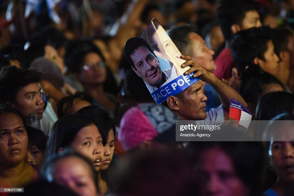 A Filipino supporter wears a hat that contains the image of the late movie star Fernando Poe Jr together with his daughter and Presidential candidate Grace Poe during a campaign rally held in Tondo district, Manila on 05 May 2016.