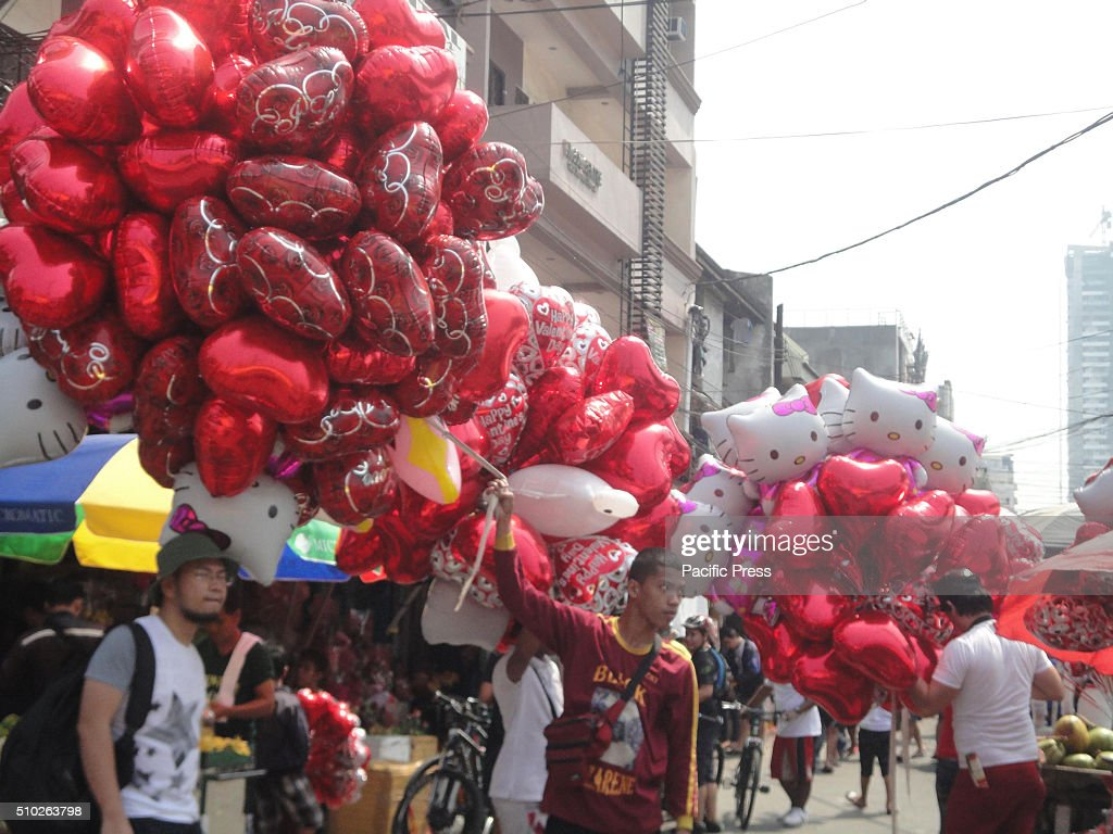 Filipino vendors sell heart-shaped balloons at the Dangwa flower market in Manila, Philippines on Valentine's Day. Valentines Day is celebrated on February 14 every year.