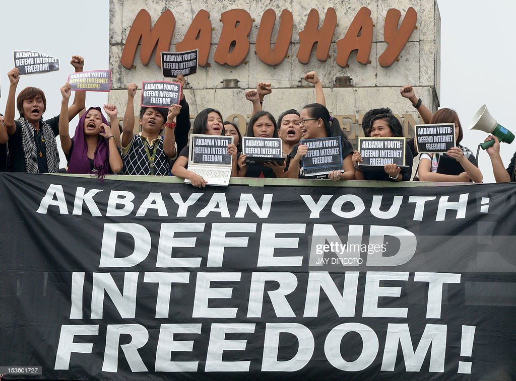 Filipino youth activists shout slogans during a rally against the Cybercrime Law in Manila on October 7, 2012. Hackers incensed by the Philippines' controversial cybercrime law have attacked government sites that deliver emergency information during natural disasters, an official said.