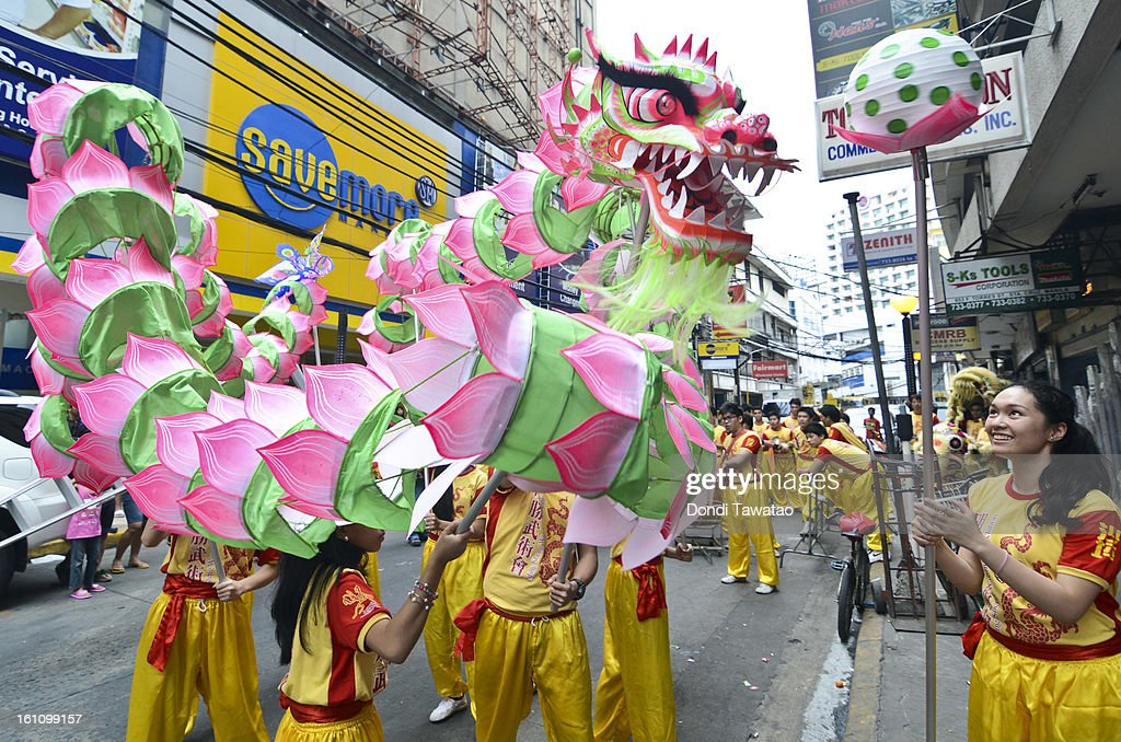 Filipino-Chinese dragon performers guide the newly-blessed lotus dragon as a form of blessing during the celebration of the Chinese New Year in the district of Binondo on February 9, 2013 in Manila, Philippines. Only after being fitted with eyelids can a dragon 'come to life', according to traditional Chinese dragon makers. The Chinese New Year begins tomorrow and this year is the year of the snake, known by locals as 'Spring Festival' or 'Lunar New Year' it is celebrated annually by Chinese Filipinos who make up roughly 20 percent of the local population.