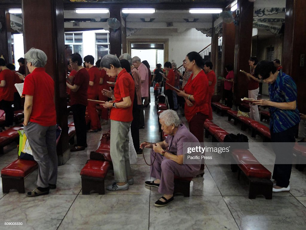 Filipino-Chinese worshippers pray at the Seng Guan Temple on Chinese New Year. This year marks the Year of the Fire Monkey in Chinese astrology.