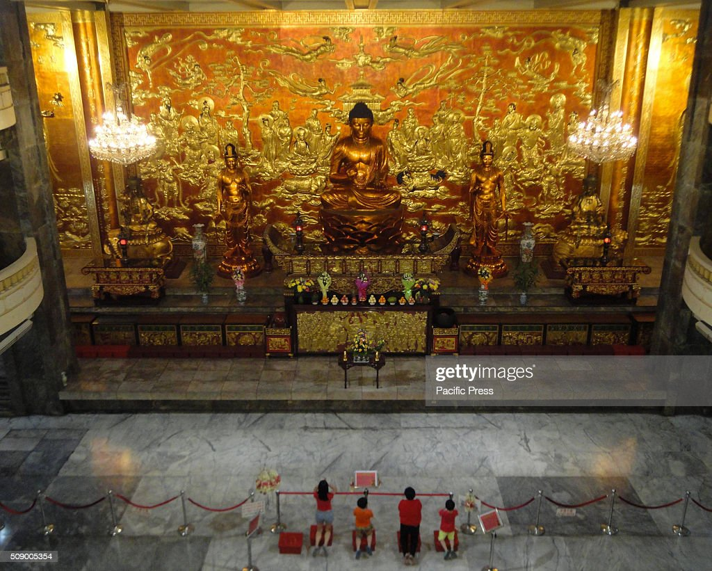 Filipino-Chinese worshippers pray before the Medicine Buddha at the Seng Guan Temple on Chinese New Year.This year marks the Year of the Fire Monkey in Chinese astrology.