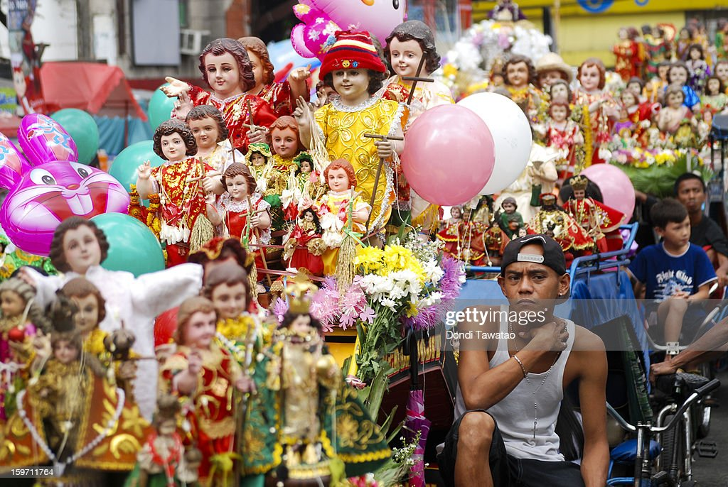 Filipinos celebrate the feast of Santo Nino with a grand procession of various images of the Child Jesus, in the district of Tondo on January 19, 2013 in Manila, Philippines. The annual Catholic celebration signals the start of religious-themed festivities in various parts of the Philippines.