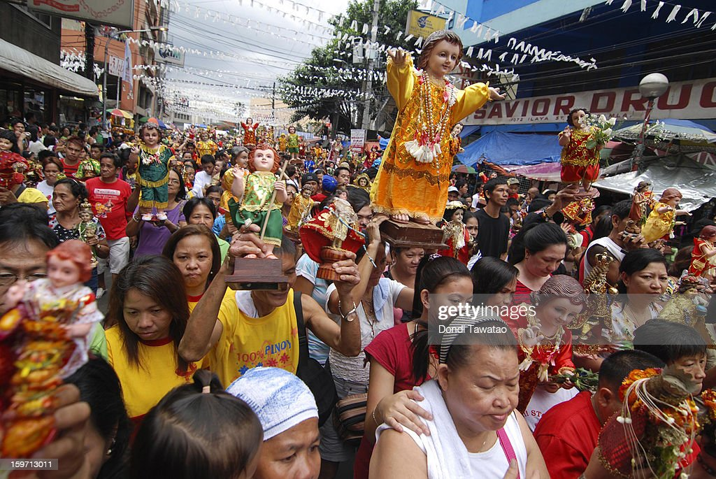 Filipinos celebrate the feast of Santo Nino with a grand procession of various images of the Child Jesus in the district of Tondo on January 19, 2013 in Manila, Philippines. The annual Catholic celebration signals the start of religious-themed festivities in various parts of the Philippines.