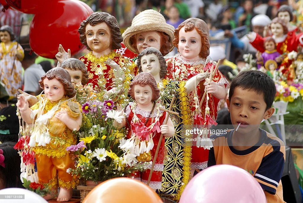 Filipinos celebrate the feast of Santo Nino with a grand procession of various images of the Child Jesus in the working class district of Tondo on January 19, 2013 in Manila, Philippines. The annual Catholic celebration signals the start of religious-themed festivities in various parts of the Philippines.