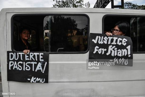Filipinos hold placards during the funeral procession of Kian Loyd Delos Santos in Caloocan Metro Manila Philippines August 26 2017 Amidst the drug...