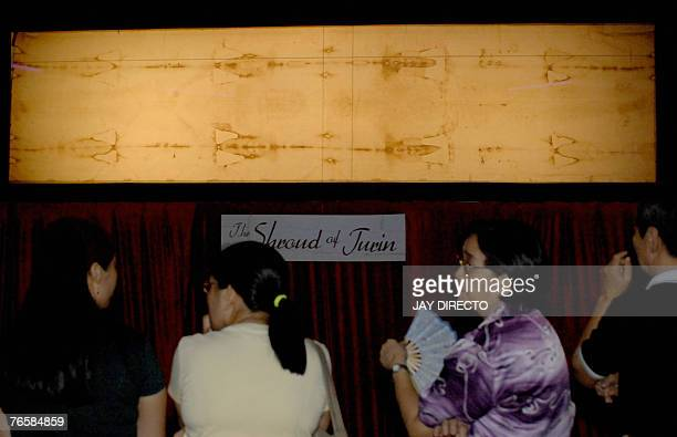 Filipinos line up to see an exhibit with a life size replica of the Shroud of Turin which allegedly had an image of Jesus Christ at the Mall of Asia...