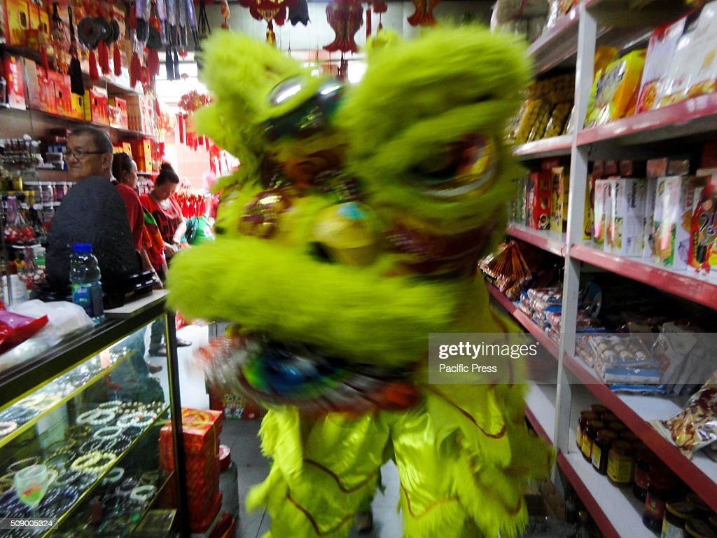 Filipinos perform a dragon dance at a store in Manila's Chinatown. This year marks the Year of the Fire Monkey in Chinese astrology.