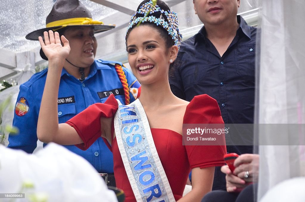 Filipinos welcome home the recently crowned Miss World 2013, <a gi-track='captionPersonalityLinkClicked' href=/galleries/search?phrase=Megan+Young&family=editorial&specificpeople=7864923 ng-click='$event.stopPropagation()'>Megan Young</a>, in Makati city on October 11, 2013 in Manila, Philippines. The 23-year-old actress and Television actress is the Philippines' first ever Miss World winner.