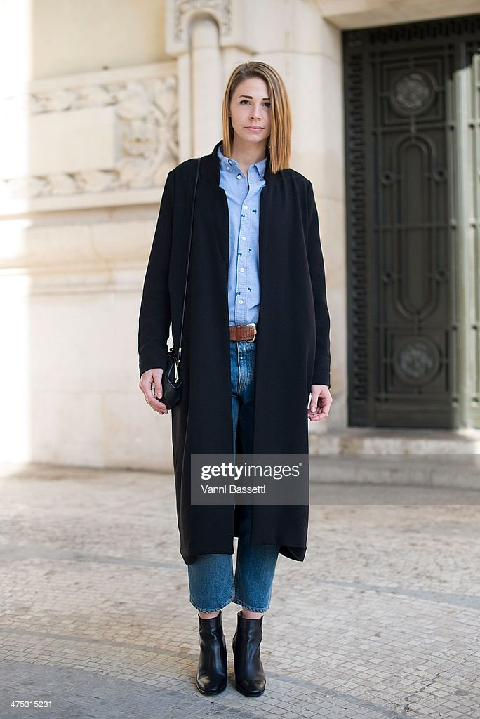 Filippa Bonde poses in a Gina Tricot coat, Acne jeans, H&M shirt and Zara shoes before Guy Laroche show at the Grand Palais on February 26, 2014 in Paris, France.