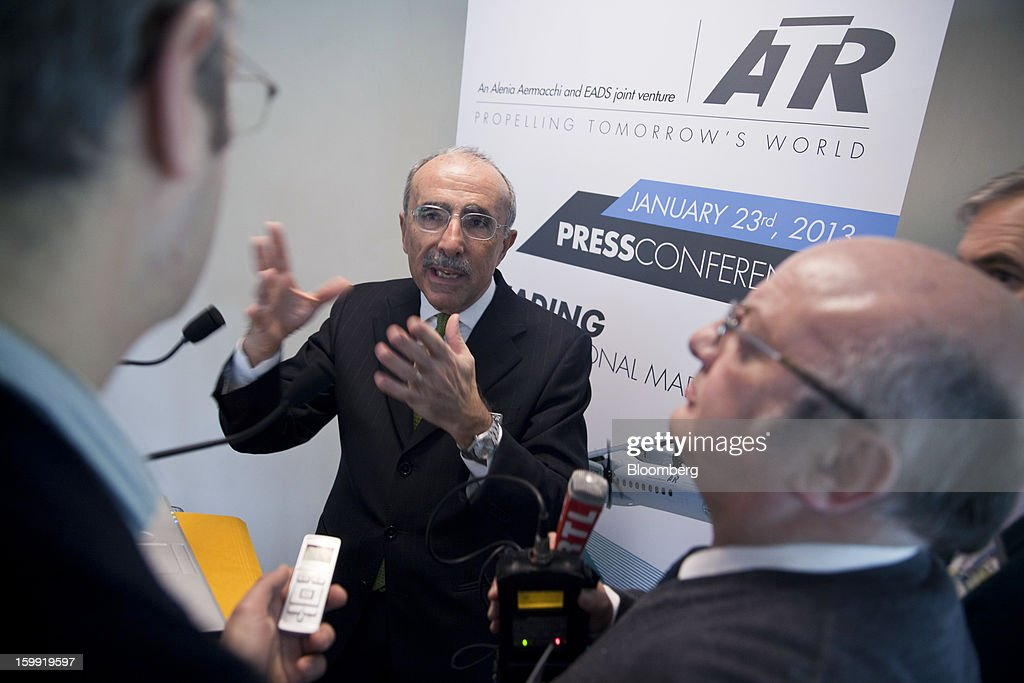 Filippo Bagnato, chief executive officer of Avions de Transport Regional (ATR), center, gestures as he speak with journalists following a news conference to announce the company's results in Colomiers, France, on Wednesday, Jan. 23, 2013. ATR, the world's largest maker of turbo-propeller airliners, reported record profit for 2012, even as it fell short of its shipment target amid production delays. Photographer: Balint Porneczi/Bloomberg via Getty Images