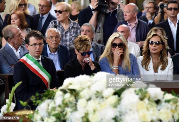 Filippo Del Corno Mara Venier and Silvana Giacobini attend Paolo Limiti funeral services at the church of Santa Maria Goretti on June 28 2017 in...
