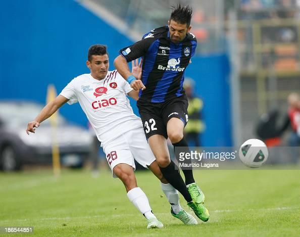 Filippo Falco of Reggina competes for the ball with Giuseppe Figliomeni of Latina during the Serie B match between US Latina and Reggina Calcio at...