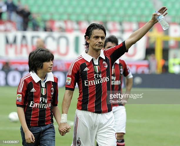 Filippo Inzaghi of AC Milan and his nephew Tommaso Inzaghi salute the audience after his last game for AC Milan during the Serie A match between AC...