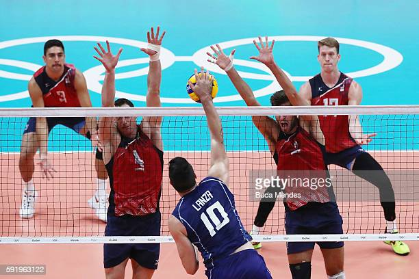 Filippo Lanza of Italy spikes at the United States during the Men's Volleyball Semifinal match on Day 14 of the Rio 2016 Olympic Games at the...