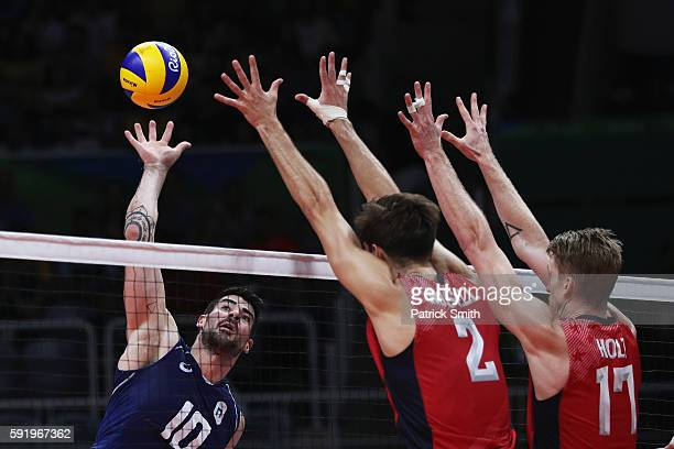 Filippo Lanza of Italy spikes the ball during the Men's Volleyball Semifinal match on Day 14 of the Rio 2016 Olympic Games at the Maracanazinho on...
