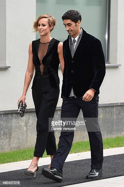 Filippo Magnini and Federica Pellegrini arrive at the Giorgio Armani show during the Milan Fashion Week on September 28 2015 in Milan Italy
