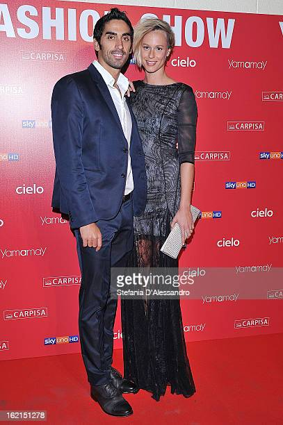 Filippo Magnini and Federica Pellegrini attend Yamamay Fashion Show cocktail party during Milan Fashion Week Fall/Winter 2013/14 at the Alcatraz on...